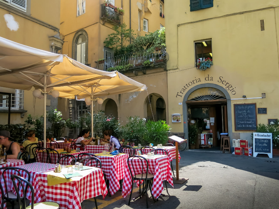 LUCCA, TUSCANY, ITALY - JULY 25, 2013 People on outdoor terrace of restaurant on Piazza Bernardini in Lucca, Tuscany, Italy
